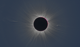 total solar eclipse showing darkened solar disk and rays emanating out in all directions