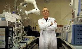Philippe Horvath standing in a lab coat with his arms crossed in a laboratory