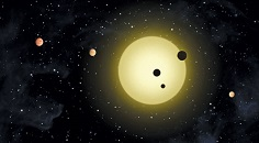 illustration of a sun with six variously sized planets orbiting it