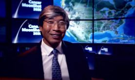a smiling Patrick Soon-Shiong in front of a glowing map of the United States