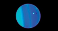 Uranus' moon Ariel (white dot) and its shadow (black dot) crossing the face of Uranus