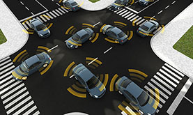 computer-simulated image of a four-way traffic stop with smart cars at various positions in the road