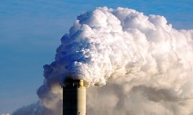 a coal power plant expelling a large amount of smoke into the atmosphere