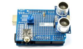 an Arduino prototyping shield holding a number of electronic components