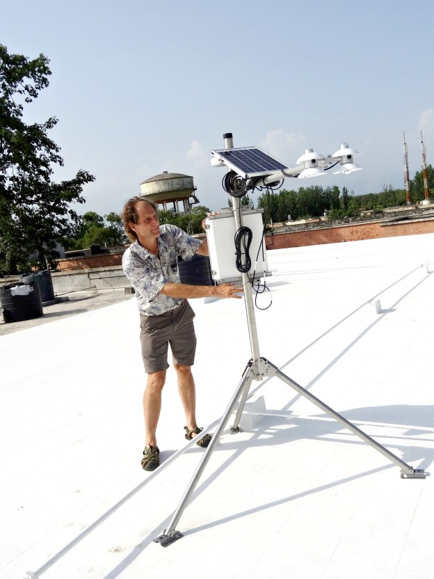 Scientist setting up equipment on a cool roof