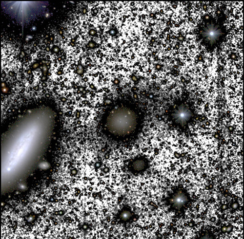 luminous blobs of varying sizes that look like and are in fact galaxies, interspersed by white instead of black representing space where a luminous galaxy is not in view