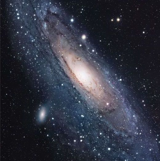 The Andromeda Galaxy displays a central, luminous bulge surrounded by a disk of radiating spiral arms.