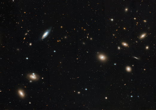 Numerous galaxies in a cluster in the constellation Coma.