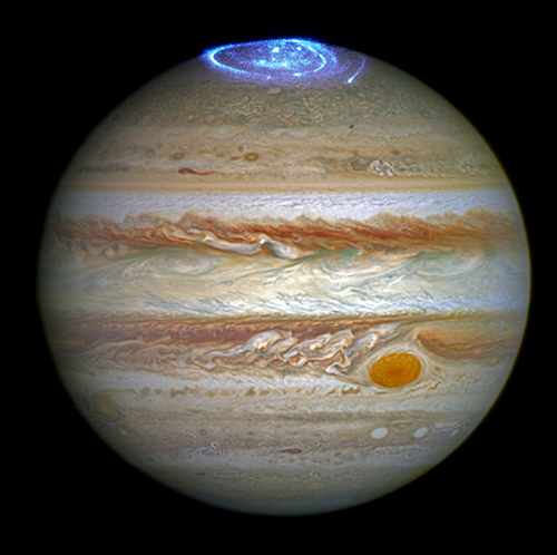 Hubble Space Telescope images of Jupiter in visible light and aurora at its north pole captured in ultraviolet light, given a representative contrasting color in this image.